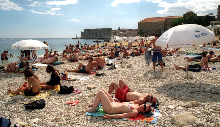 Sun bathers relax on the pebbled beach outside Dubrovnik, Croatia.With the Cruising Croatia and Adriatic Islands Package, you get round-trip airfare, three nights' hotel accommodations, seven nights aboard a small ship, meals, land transportation, and shore excursions, from $2,295 per person.