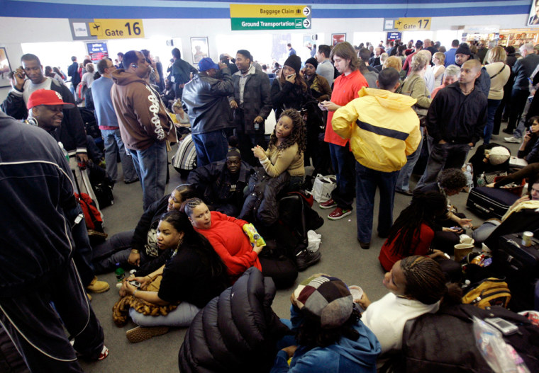 During a snow and ice storm on Feb. 15, JetBlue Airways passengers waited for flights, while onboard passengers were left waiting on planes for as long as nine hoursat New York's Kennedy Airport. A report released by the DOT Tuesday makes several suggestions to deal with delays and burdened passengers — but proposed no penalties for failure to comply.