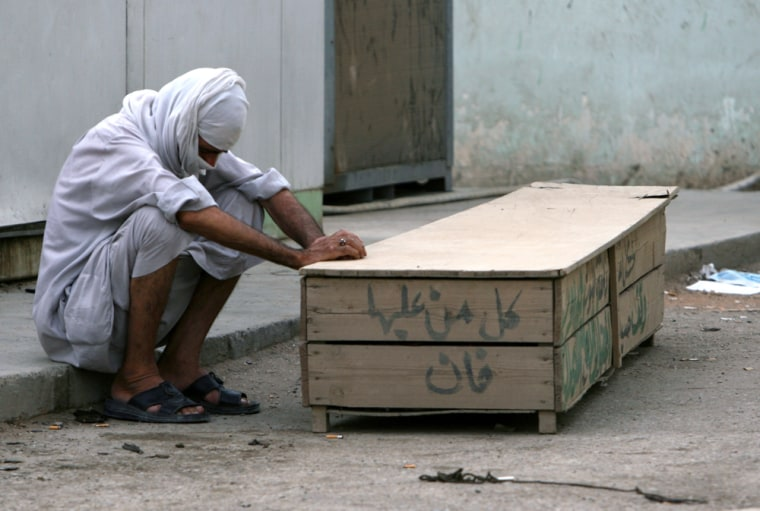A man grieves overa loved one killed in Tuesday's attack on a Shiite mosque in central Baghdad.