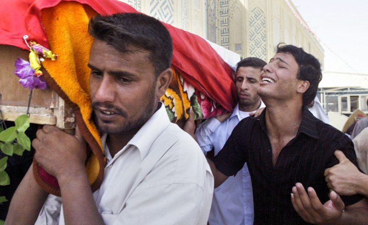 Shaker Dana, right, weeps for his brother Wisam Dana, 27, in Najaf, Iraq on Wednesday. The Iraqi soldier was killed by a car bomb in Anbar province on Monday.