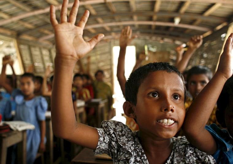 Bangladeshi village children attend a school at a boat