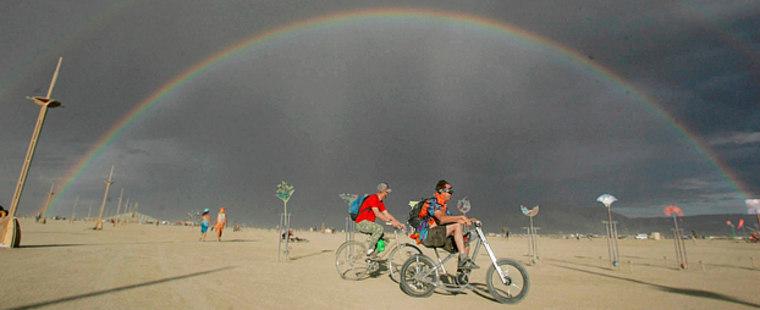 A rainbow is cast over the Black Rock Desert in Gerlach, Nev., during the Burning Man festival on Friday, Aug. 31, 2007. (AP Photo/Brad Horn)