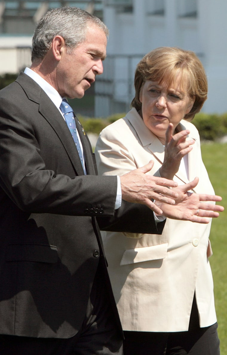 German Chancellor Angela Merkel (R) spea