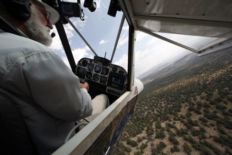 Volunteer John Morgan fliesin search of missing adventurer Steve FossetonSept. 12 in Minden, Nev.