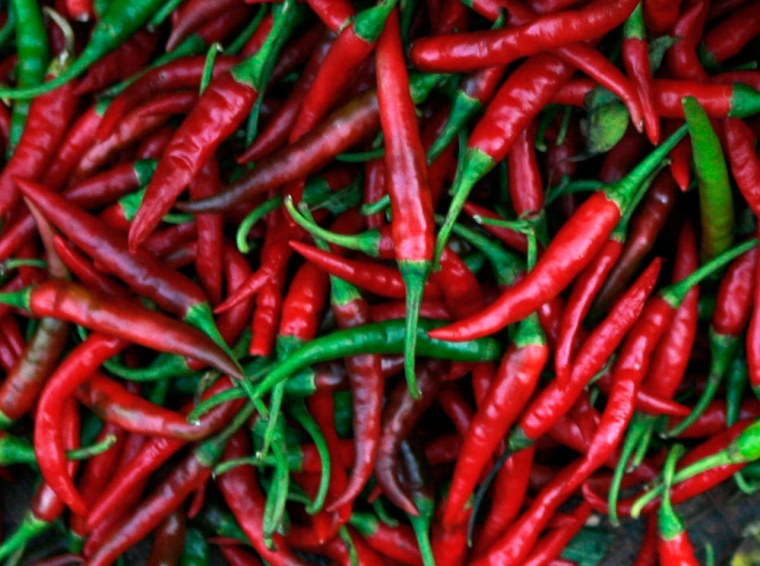 A street vendor sorts chillies at a large wet market in Quezon City, Metro Manila