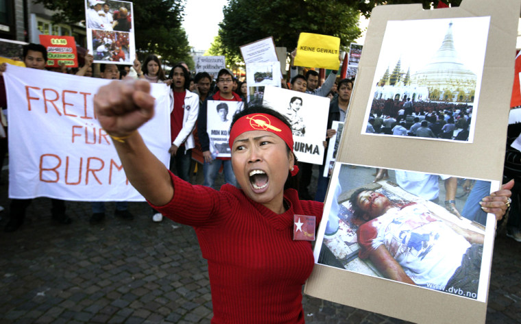 A woman shouts slogan's against Myanmar'S generals during a demonstration as part of the Myanmar global day of protest in Frankfurt