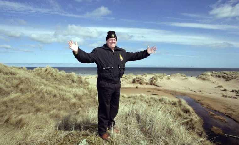 Donald Trump stands on Scottish dunes that have become a battleground over his plans for a golf resort.