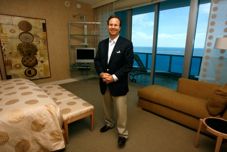 """Donn Davis, chairman of Exclusive Resorts, poses for a portrait inside an Exclusive Resorts residence inside the """"Bath Club"""" in Miami, Fla."""