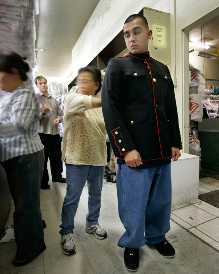 Marine Sgt. Mark Castro Elias is fitted for a dress jacket in Oceanside, Calif., on Tuesday.The Marine Corps is banning the wearing of camouflage uniforms off base, even during coffee runs and quick stops at the cleaners.