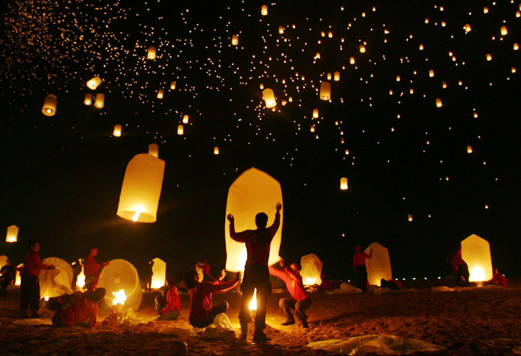 Floating paper lanterns fill the sky over the Andaman Sea in remembrance of tsunami victims in Khao Lak
