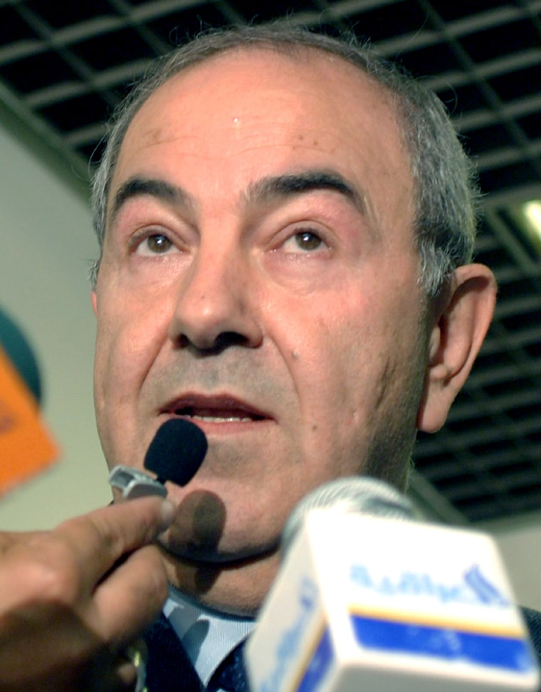 Iraq's Prime Minister Iyad Allawi speaks to reporters in the capital Baghdad