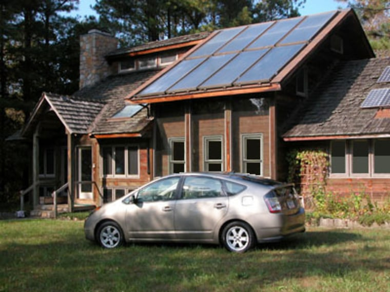 Is this lifestyle in the cards for you? A hybrid Prius sits in front of a Raleigh, N.C., home powered bythe sunand built by Enertia Building Systems, which has built similar homes in 30 states.