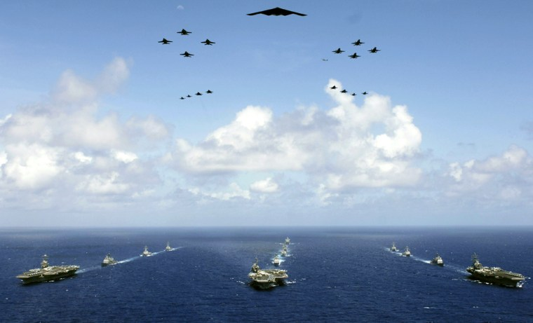 The USS Abraham Lincoln, USS Kitty Hawk and USS Ronald Reagan carriergroups steam in formation near Guam Sunday during preparations forValiant Shield.