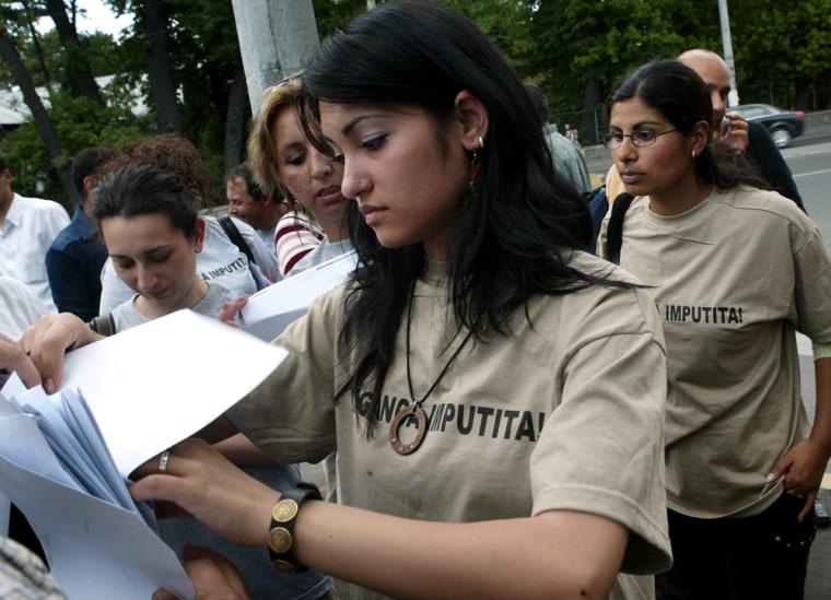 A Romanian Roma woman wearing a T-shirt