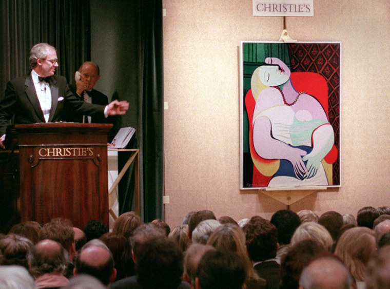 """Picasso's """"Le Reve"""" is auctioned on Nov. 10, 1997, at Christie's auction house in New York. Casino mogul Steve Wynn will keep and restore the painting, which he accidentally damaged shortly after he had agreed to sell it for a record $139 million."""