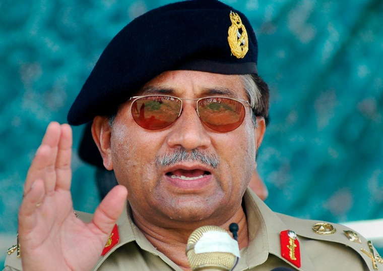 File photo of Pakistan's President Pervez Musharraf speaking to flood victims during a visit to the storm-hit town of Turbat