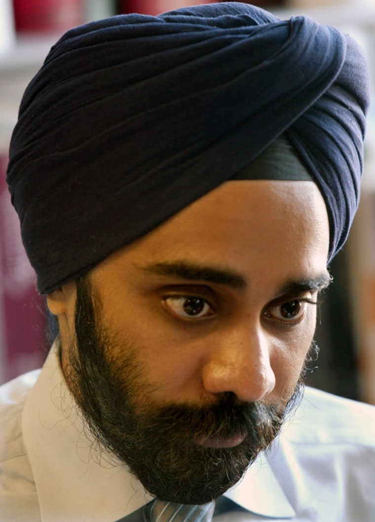 Amardeep Singh, executive director The Sikh Coalition in New York, reviews documents at his office in New York. A new airport screening policy for turbans and other headwear has the country's Sikhs concerned they are being unfairly targeted.