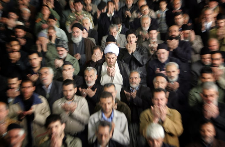 Iranians worshippers perform the weekly