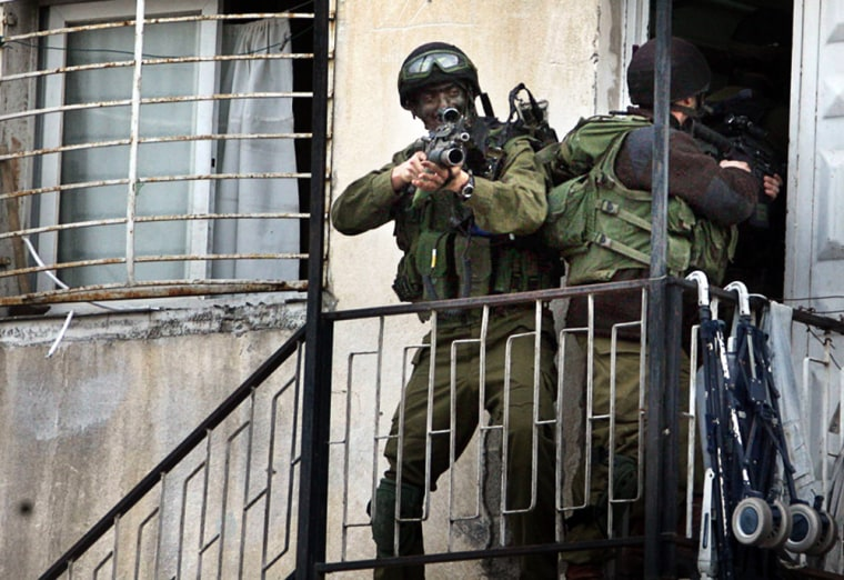 Israeli soldiers search a building durin