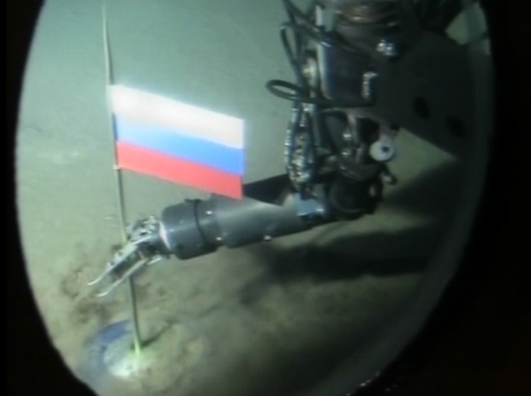 Russian explorers on Aug. 3, 2007, planted a Russian flag  during a remote-controlled dive in the Arctic Ocean under the ice at the North Pole.