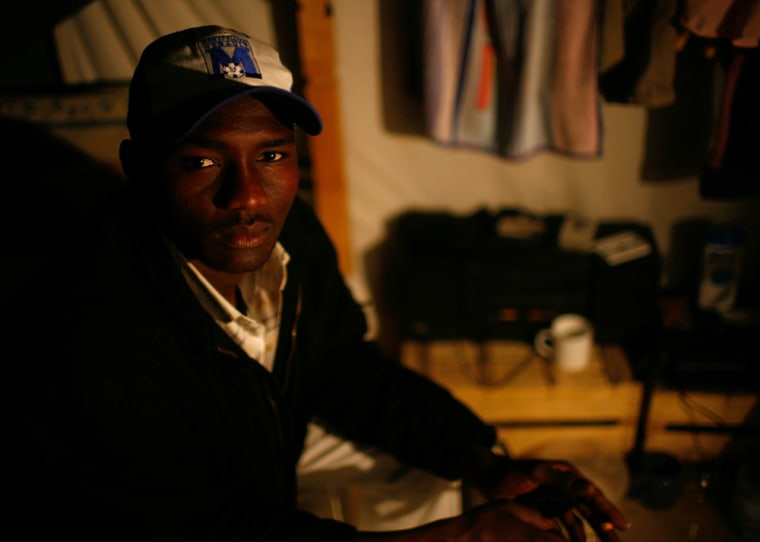 Ahmed Waddai, a 24-year-old from Chad, sits on hisbunk bed the Hal Far Open Center.