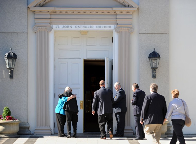 Mourners enter St. John's Catholic Church for a memorial service on Saturday for Bruce Ivins, the Army scientist suspected in the anthrax attacks.