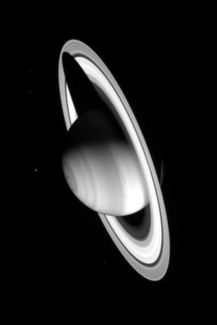 IMAGE SHOWING SATURN CASTING A SHADOW OVER ITS RINGS TAKEN BY CASSINI SPACECRAFT