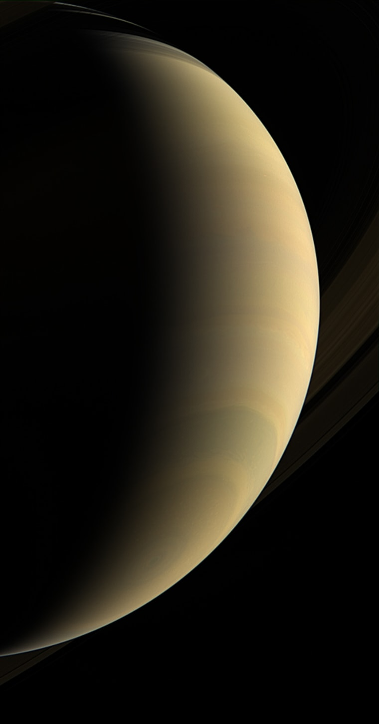 Cassini coasts beneath giant Saturn, staring upward at its gleaming crescent and icy rings.  A great bull's-eye pattern is centered on the south pole, where a vast, hurricane-like storm spins.  This view looks toward the lit side of the rings from about 26 degrees below the ring plane. The view was acquired about two hours prior to PIA08347 </catalog/PIA08347>.  Images taken using red, green and blue spectral filters were combined to create this natural-color view. The images were obtained with the Cassini spacecraft wide-angle camera on Jan. 30, 2007, at a distance of approximately 1.1 million kilometers (700,000 miles) from Saturn. Image scale is 61 kilometers (38 miles) per pixel.  The Cassini-Huygens mission is a cooperative project of NASA, the European Space Agency and the Italian Space Agency. The Jet Propulsion Laboratory, a division of the California Institute of Technology in Pasadena, manages the mission for NASA's Science Mission Directorate, Washington, D.C. The Cassini orbiter and its two onboard cameras were designed, developed and assembled at JPL. The imaging operations center is based at the Space Science Institute in Boulder, Colo.