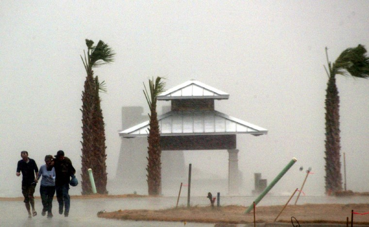 People run off pier as Hurricane Ivan comes ashore in Pensacola Florida