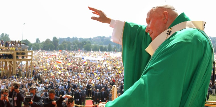 POPE JOHN PAUL II WAVES TO A CROWD DURING A MASS AT KRAKOWS BLONIE MEADOW