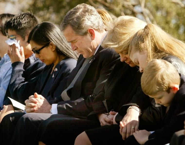 Image:  President George W. Bush bows his head in prayer