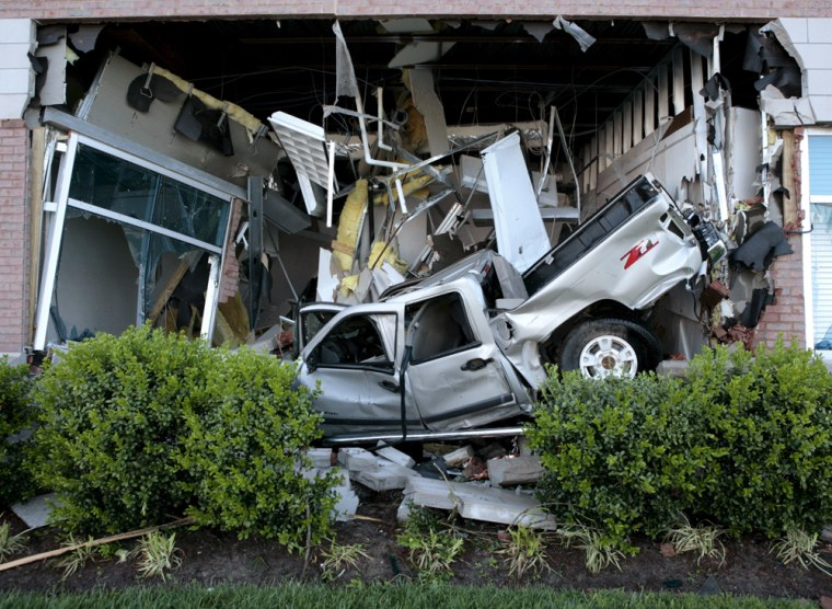 Image:  A pick up truck thrown by a tornado