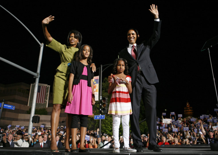 US Democratic presidential candidate Senator Barack Obama (D-IL) and his wife and daughters onstage at election night rally in Des Moines