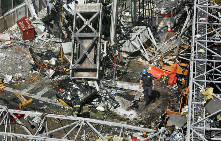 Rescue workers look through wreckage after a construction crane collapsed on New York's Upper East Side on May 30, 2008. It was the second deadly crane accident in 2 1/2 months in the city.