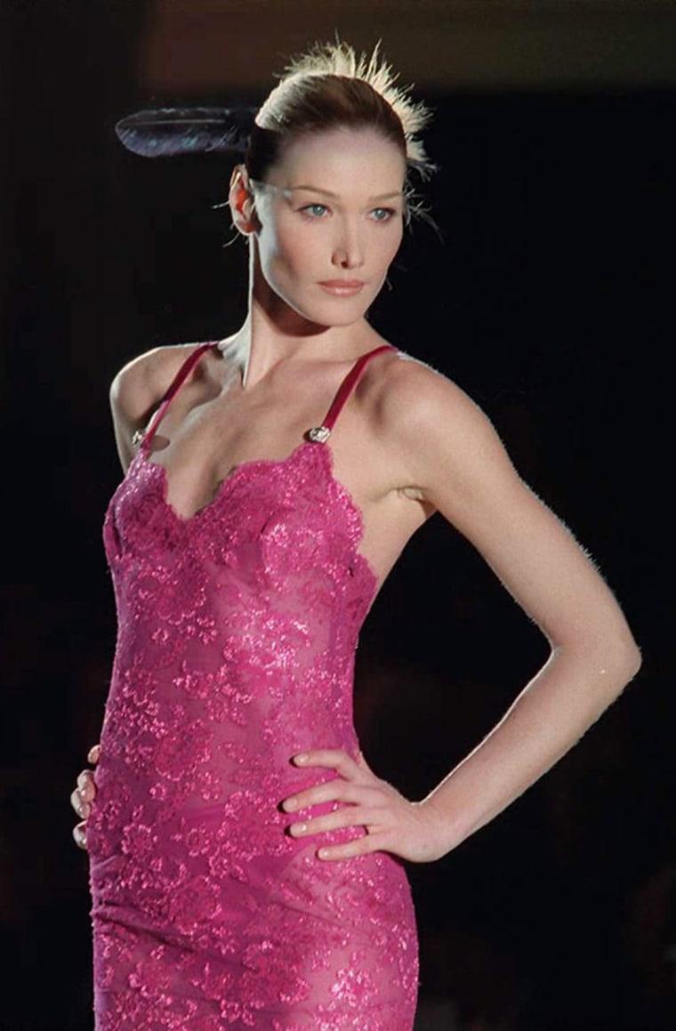 Italian model Carla Bruni shows a pink evening gow