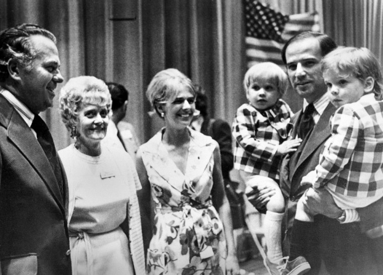 Sen. Joe Biden (D-Del.) carries both of his sons, Joseph R. III, left, and Robert H., during an appearance at the Democratic state convention last summer, 1972.  At center is his wife Neilia Biden, who was killed in an auto crash, Dec. 20, 1972. With them are Governor-elect Sherman W. Tribbitt and his wife, Jeanne. (AP Photo)