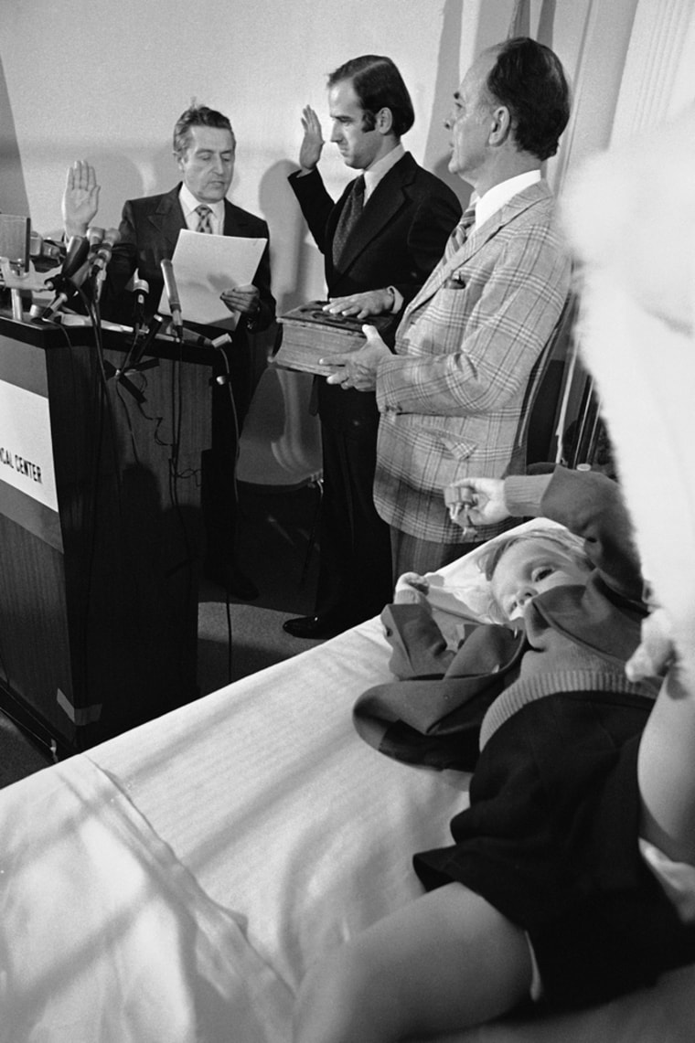 ** FILE **In this Jan. 5, 1973, file photo, four-year-old Beau Biden, foreground, watches his dad, Joe Biden, center, being sworn in as the U.S. senator from Delaware, by Senate Secretary Frank Valeo, left, in ceremonies in a Wilmington hospital.  Beau was injured in an accident that killed his mother and sister in December.  Mrs. Biden's father, Robert Hunter, holds the bible. Barack Obama selected Sen. Joe Biden of Delaware late Friday night Aug. 22, 2008 to be his vice presidential running mate, according to a Democratic official, balancing his ticket with an older congressional veteran well-versed in foreign policy and defense issues. In Washington, Biden, 65, is known as a collegial figure even when he's competitive _ one who can spin flowery praise one moment and biting fulmination the next. (AP Photo, FILE)