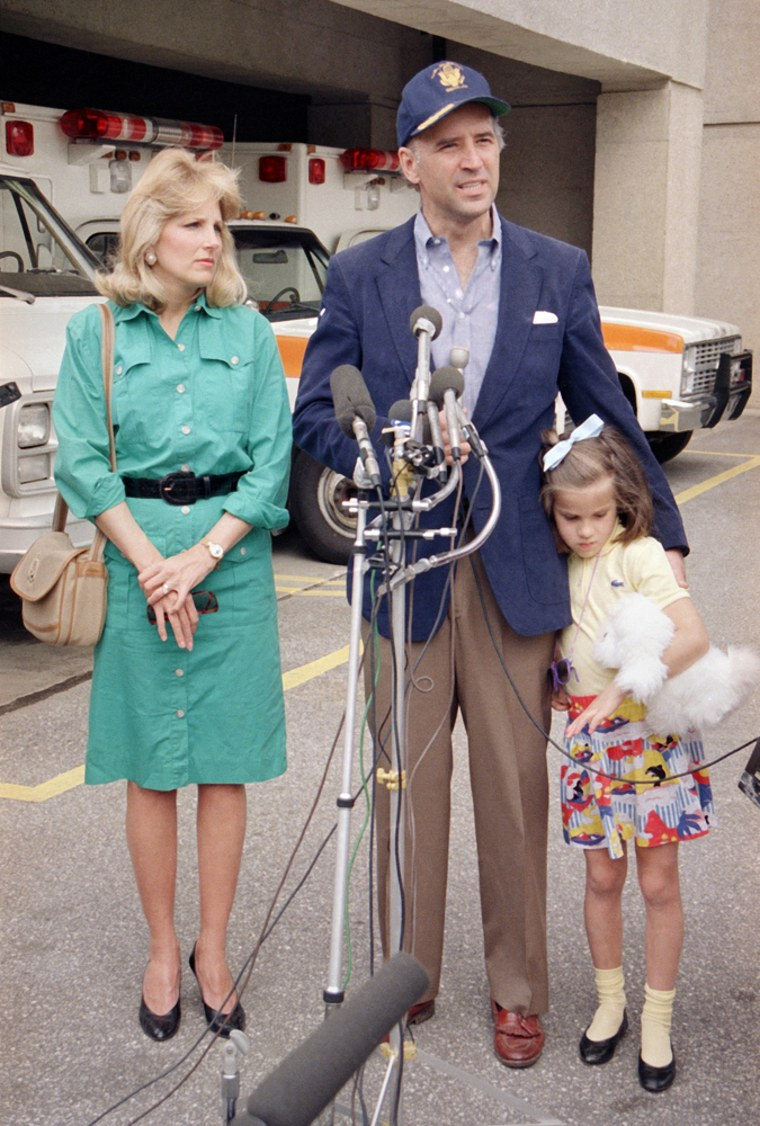 Sen. Joe Biden (D-Del.), flanked by his wife Jill and daughter Ashley, meets with reporters following his release form Walter Reed Army Medical Center in Washington, May 21, 1988.  Biden underwent successful surgery earlier this month to correct an aneurysm near his brain. (AP Photo/Adelle Starr)