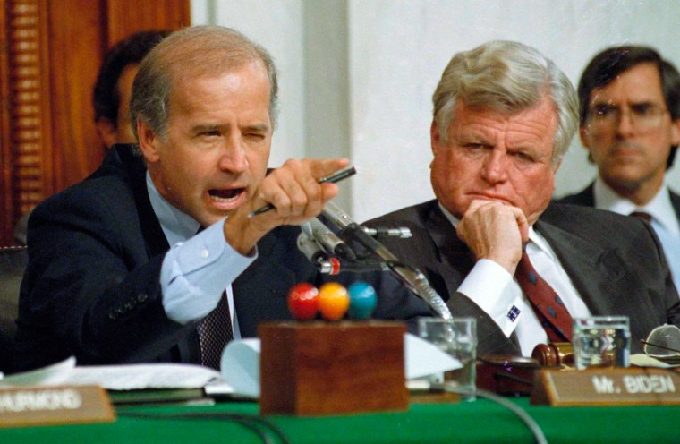 ** FILE **In this Oct. 12, 1991 file photo Senate Judiciary Committee Chairman Joe Biden, D-Del., points angrily at Clarence Thomas during comments at the end of hearings on Thomas' nomination to the Supreme Court on Capitol Hill. Sen. Edward Kennedy, D-Mass. looks on at right. Barack Obama selected Sen. Joe Biden of Delaware late Friday night Aug. 22, 2008 to be his vice presidential running mate, according to a Democratic official, balancing his ticket with an older congressional veteran well-versed in foreign policy and defense issues. In Washington, Biden, 65, is known as a collegial figure even when he's competitive _ one who can spin flowery praise one moment and biting fulmination the next. (AP Photo/Greg Gibson, File)