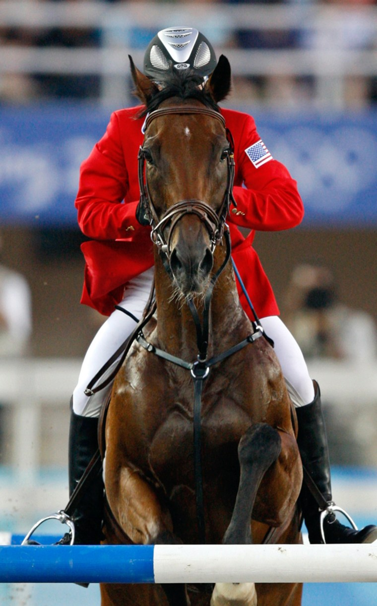 Taormina of the U.S. clears a jump on horse LiangLiang during the women's riding show jumping event of the modern pentathlon competition at the Beijing 2008 Olympic Games
