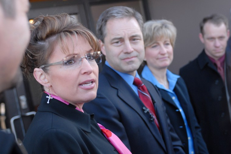 At left, Alaska Gov. Sarah Palin announces her endorsement of Lt. Gov. Sean Parnell, center, in his run for Alaska's congressional seat Friday, March 14, 2008 at the state elections office in Anchorage, Alaska.  Parnell had just filed to run against incumbent Republican Don Young for U.S. Congress. At right is Parnell's wife Sandy.  (AP Photo/Michael Dinneen)