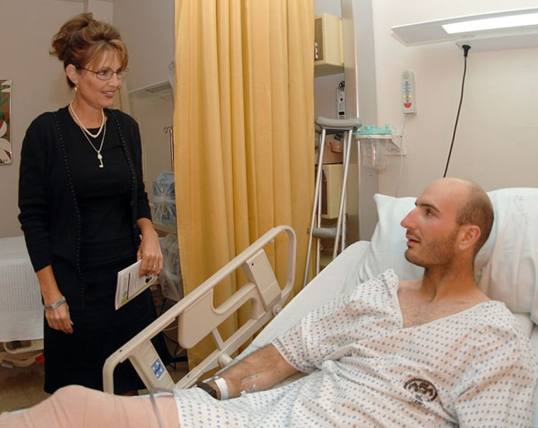 Gov. Sarah Palin visits Army Pfc. John Kegley during a morale tour at Landstuhl Regional Medical Center, Landstuhl, Germany, July 26, 2007. Kegley is from Alaska and is being treated at LRMC for injuries he suffered while downrange.