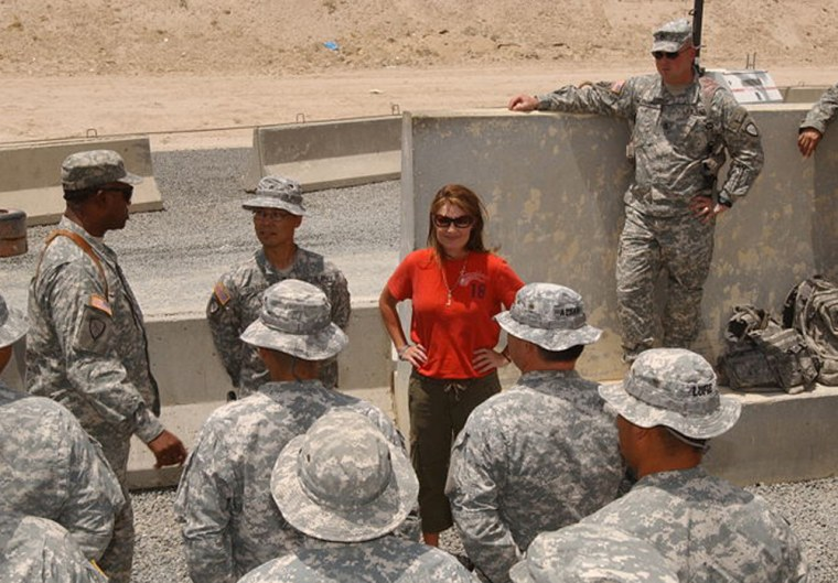 Gov. Sarah Palin, of Alaska, looks over a squad of Soldiers from her state during a visit to Camp Virginia, Kuwait, July 25. The tour of the desert camp culminated at lunch with her Alaska National Guard Soldiers in the dining facility.