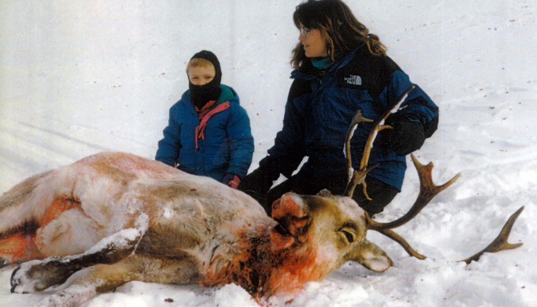 This undated photo provided by the Heath family shows Alaska Gov. Sarah Palin with one of her daughters posing with the caribou she shot in Alaska.