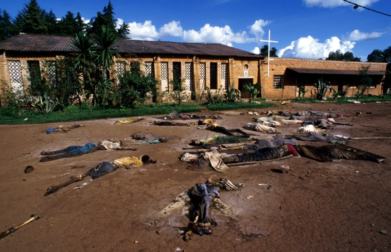 Bodies of Tutsi genocide victims lie outside a church