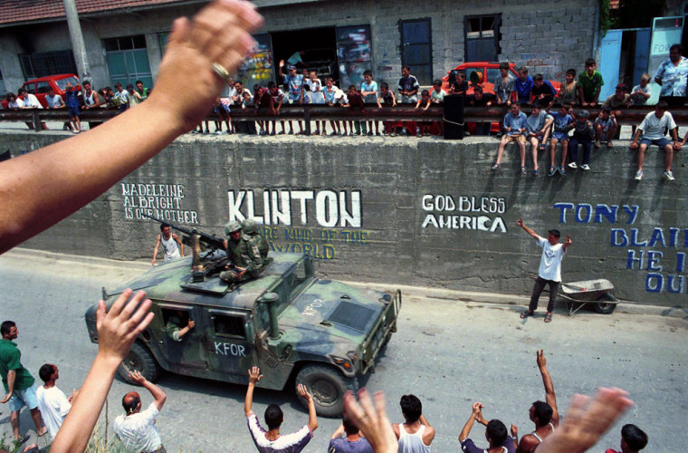 Ethnic Albanians Greet American NATO Troops As They Pass Through The Town Of Gnjilane June 30 1999