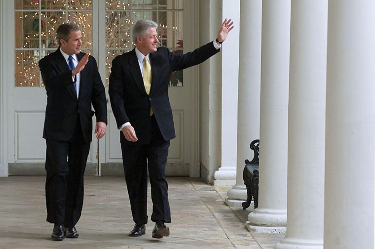 US President BIll Clinton (R) and President-elect