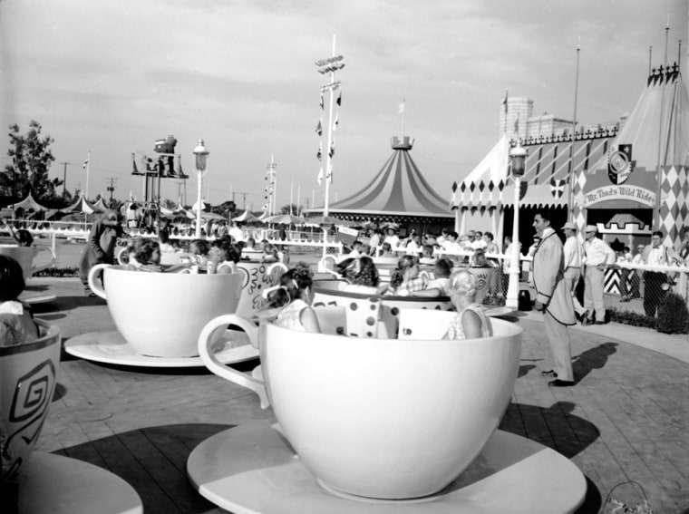 Children are enjoying the cup and saucer ride in Disneyland in Anaheim, Calif., on July 19, 1955. (AP Photo)