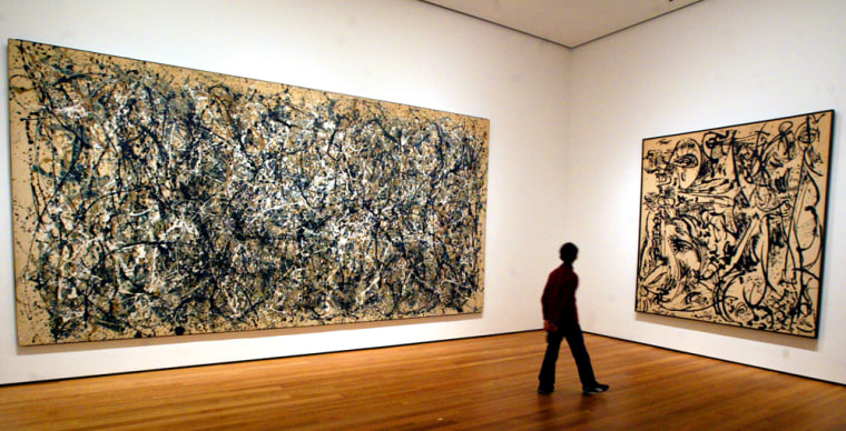A visitor strolls by the artwork of Jackson Pollock at the Museum of Modern Art in New York.
