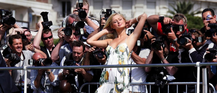 US hotels heiress Paris Hilton poses at photocall on the Carlton Hotel pier during 58th Cannes Film Festival